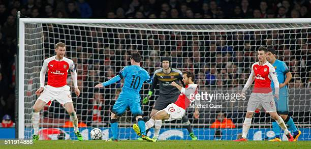 Lionel Messi of Barcelona is fouled by Mathieu Flamini of Arsenal for a penalty during the Champions League match between Arsenal and Barcelona at...