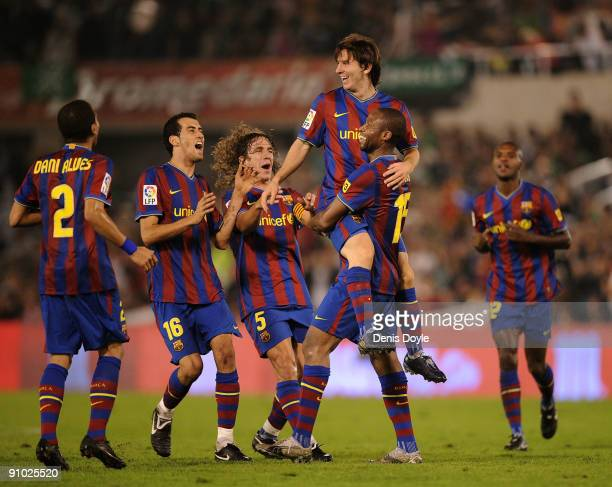 Lionel Messi of Barcelona is lifted up by Seydou Keita after scoring the 40 goal against Racing Santander during the La Liga match between Racing...