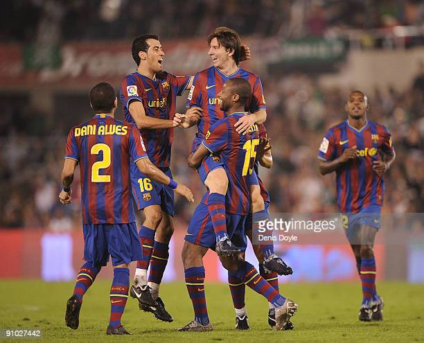 Lionel Messi of Barcelona is lifted up by Seydou Keita after scoring Barcelona's fourth goal against Racing Santander during the La Liga match...
