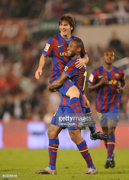 Lionel Messi of Barcelona is lifted up by teammate Seydou Keita after scoring the 40 goal against Racing Santander during the La Liga match between...