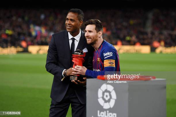 Lionel Messi of Barcelona is presented with the La Liga player of the month award by Patrick Kluivert prior to the La Liga match between FC Barcelona...