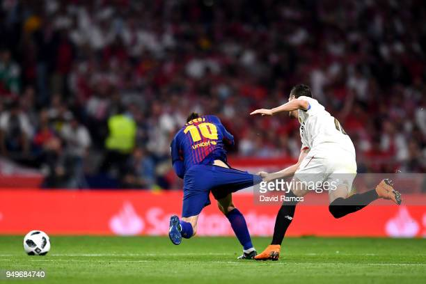 Lionel Messi of Barcelona is pulled down by his shorts by Sevilla's Sergio Escudero during the Spanish Copa del Rey match between Barcelona and...