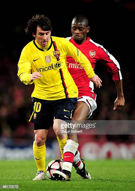 Lionel Messi of Barcelona is tackled by Abou Diaby of Arsenal during the UEFA Champions League quarter final first leg match between Arsenal and FC...