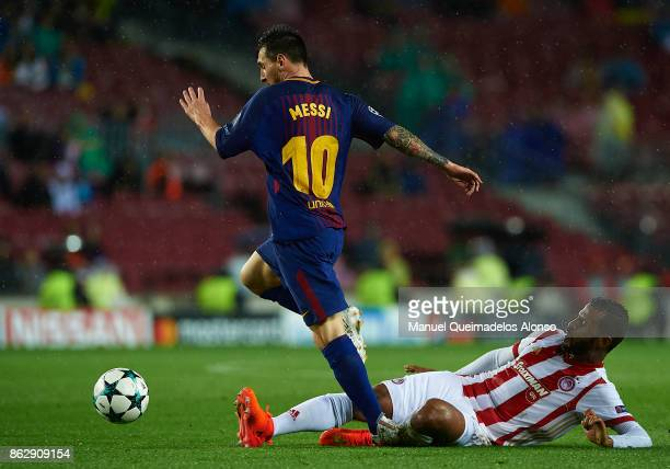 Lionel Messi of Barcelona is tackled by Alaixys Romao of Olympiakos during the UEFA Champions League group D match between FC Barcelona and...