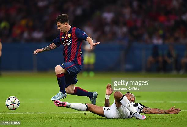 Lionel Messi of Barcelona is tackled by Arturo Vidal of Juventus during the UEFA Champions League Final between Juventus and FC Barcelona at...