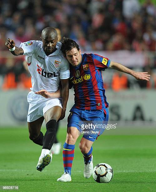 Lionel Messi of Barcelona is tackled by Didier Zokora of Sevilla during the La Liga match between Sevilla and Barcelona at Estadio Ramon Sanchez...
