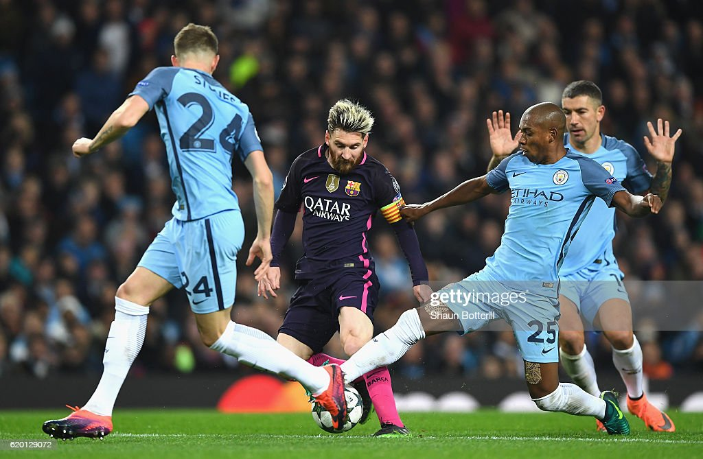 Lionel Messi of Barcelona (C) is tackled by Fernandinho of Manchester City (R) during the UEFA Champions League Group C match between Manchester City FC and FC Barcelona at Etihad Stadium on November 1, 2016 in Manchester, England.