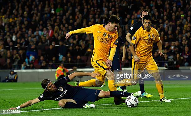 Lionel Messi of Barcelona is tackled by Filipe Luis of Atletico Madrid during the UEFA Champions League quarter final first leg match between FC...