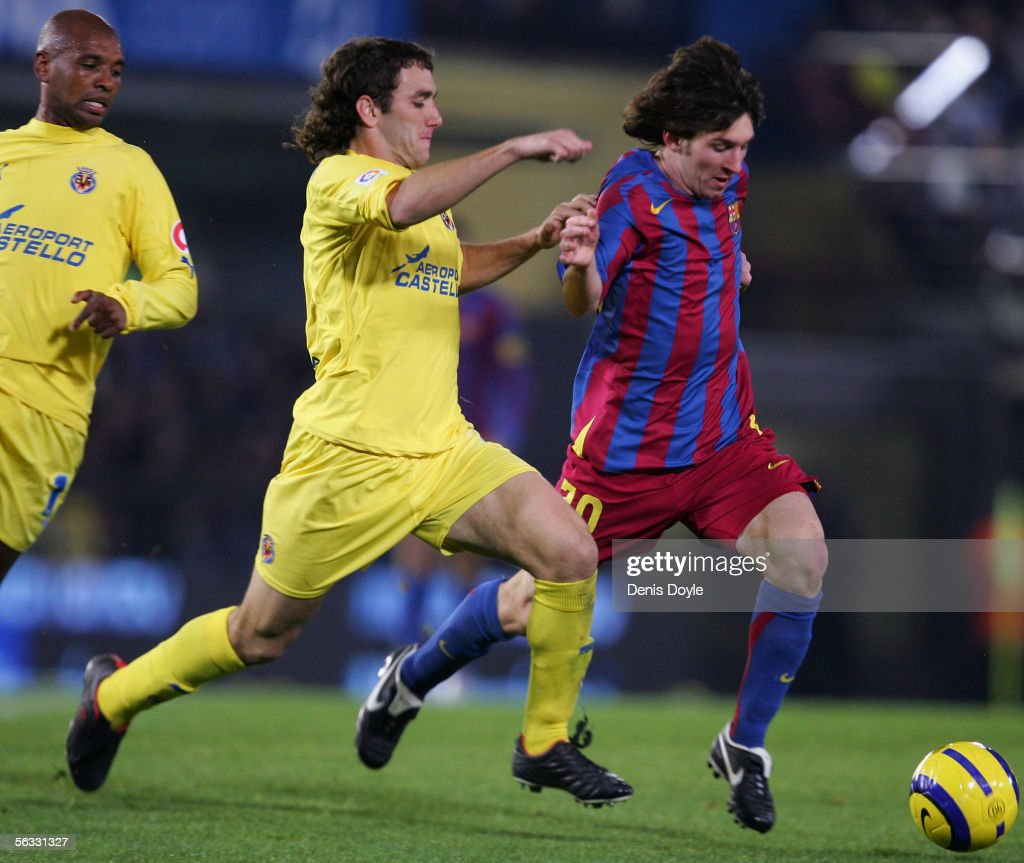 Lionel Messi (R) of Barcelona is tackled by Gonzalo Rodriguez of Villarreal during the Primera Liga match between Villarreal and F.C. Barcelona on December 4, 2005 at the Madrigal stadium in Villarreal, Spain.