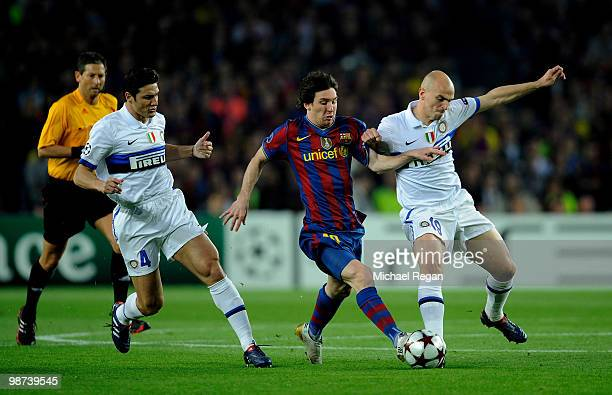 Lionel Messi of Barcelona is tackled by Javier Zanetti and Esteban Cambiasso of Inter Milan during the UEFA Champions League Semi Final Second Leg...