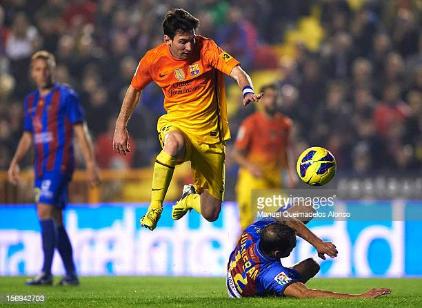 Lionel Messi of Barcelona is tackled by Juanfran of Levante during the la Liga match between Levante UD and FC Barcelona at Ciutat de Valencia on...
