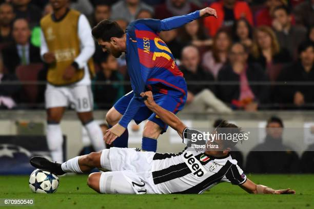 Lionel Messi of Barcelona is tackled by Paulo Dybala of Juventus during the UEFA Champions League Quarter Final second leg match between FC Barcelona...