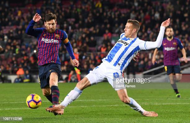 Lionel Messi of Barcelona is tackled by Rodrigo Tarin of Leganes during the La Liga match between FC Barcelona and CD Leganes at Camp Nou on January...