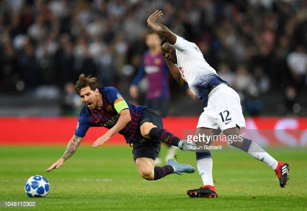 Lionel Messi of Barcelona is tackled by Victor Wanyama of Tottenham Hotspur during the Group B match of the UEFA Champions League between Tottenham...