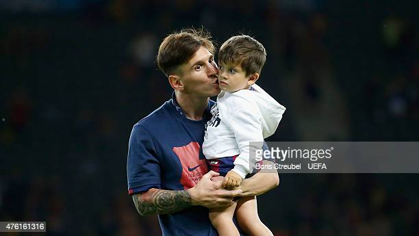 Lionel Messi of Barcelona kisses his son Thiago Messi after winning the UEFA Champions League Final match between Juventus and FC Barcelona at...