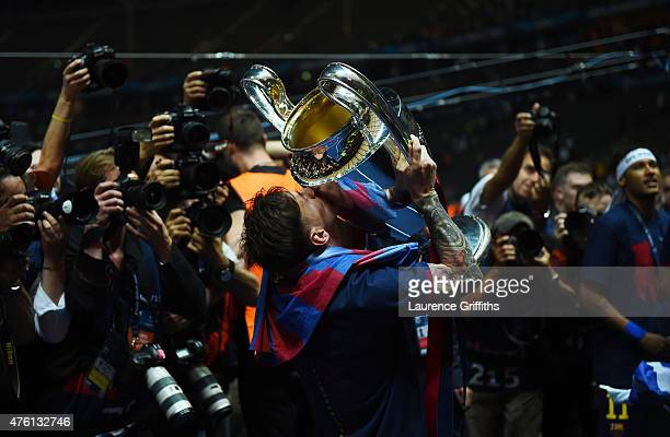 Lionel Messi of Barcelona kisses the trophy as he celebrates victory after the UEFA Champions League Final between Juventus and FC Barcelona at...