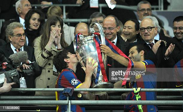 Lionel Messi of Barcelona kissing the trophy with teammate Javier Mascherano after the UEFA Champions League final between FC Barcelona and...