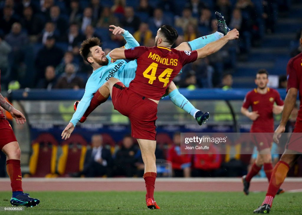 Lionel Messi of Barcelona, Kostas Manolas of AS Roma during the UEFA Champions League Quarter Final second leg match between AS Roma and FC Barcelona (Barca) at Stadio Olimpico on April 10, 2018 in Rome, Italy.