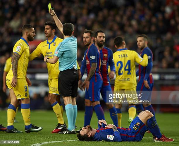 Lionel Messi of Barcelona lies injured on the pitch during the La Liga match between FC Barcelona and UD Las Palmas at Camp Nou Stadium on January 14...