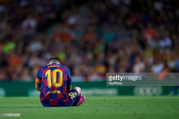 Lionel Messi of Barcelona lies injured on the pitch during the Liga match between FC Barcelona and Villarreal CF at Camp Nou on September 24, 2019 in...