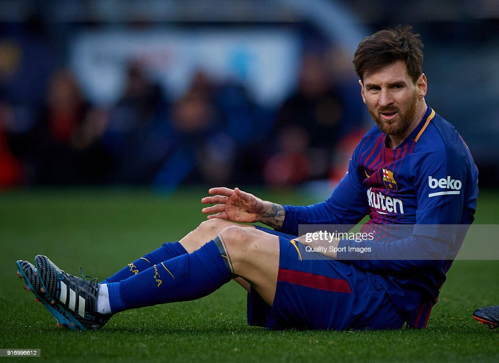 Lionel Messi of Barcelona lies on the pitch during the La Liga match between Barcelona and Getafe at Camp Nou on February 11, 2018 in Barcelona, Spain.