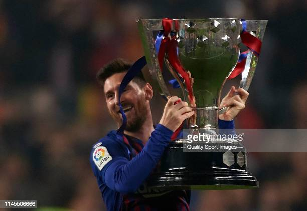 Lionel Messi of Barcelona lifts the La Liga trophy after the La Liga match between FC Barcelona and Levante UD at Camp Nou on April 27, 2019 in...
