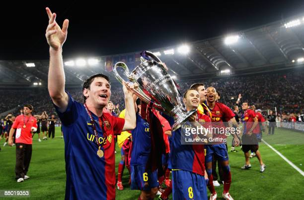 Lionel Messi of Barcelona lifts the trophy as he and his team mates celebrates winning the UEFA Champions League Final match between Barcelona and...