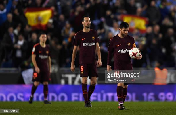 Lionel Messi of Barcelona looks dejected after Espanyol score their first goal during the Spanish Copa del Rey Quarter Final First Leg match between...