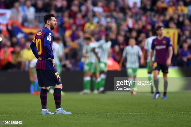 Lionel Messi of Barcelona looks dejected as Junior Firpo of Real Betis scores his team's first goal during the La Liga match between FC Barcelona and...