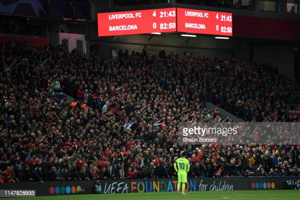 Lionel Messi of Barcelona looks dejected as the scoreboard reads '4-0' during the UEFA Champions League Semi Final second leg match between Liverpool...