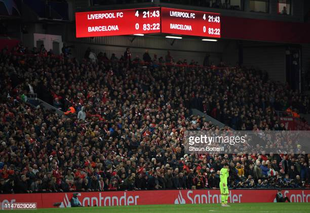 Lionel Messi of Barcelona looks dejected as the scoreboard reads '40' during the UEFA Champions League Semi Final second leg match between Liverpool...
