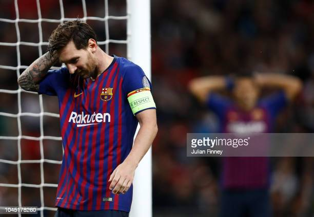 Lionel Messi of Barcelona looks dejected during the Group B match of the UEFA Champions League between Tottenham Hotspur and FC Barcelona at Wembley...