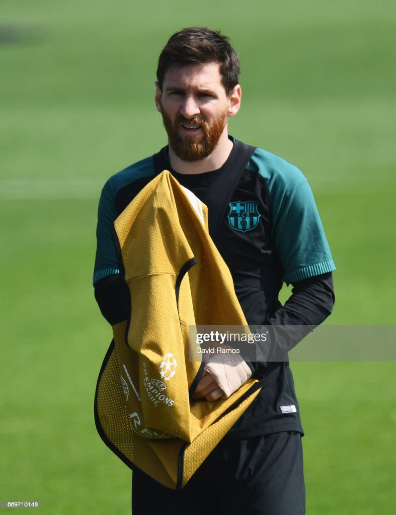 Lionel Messi of Barcelona looks on during a FC Barcelona training session on the eve of their UEFA Champions League quarter final second leg match against Juventus at FC Barcelona Sports Centre on April 18, 2017 in Barcelona, Spain.