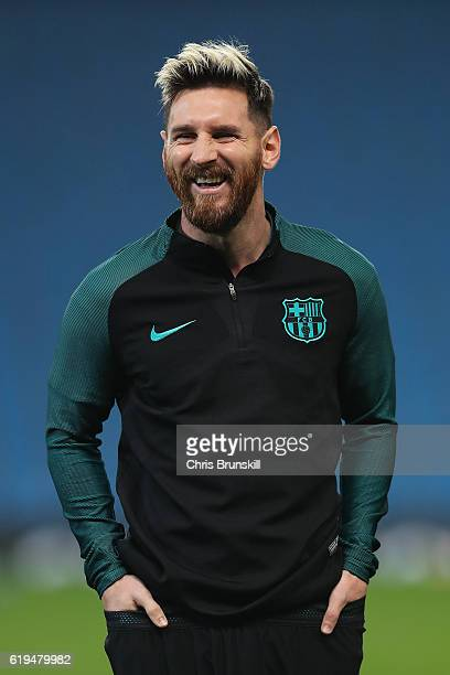 Lionel Messi of Barcelona looks on during a training session ahead of the UEFA Champions League match between Manchester City and Barcelona at the...