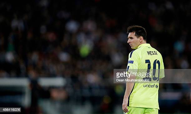 Lionel Messi of Barcelona looks on during the Group F UEFA Champions League match between Paris SaintGermain v FC Barcelona held at Parc des Princes...