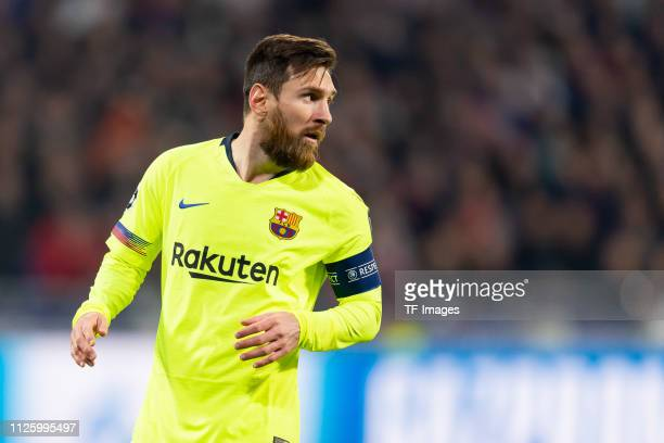 Lionel Messi of Barcelona looks on during the UEFA Champions League Round of 16 First Leg match between Olympique Lyonnais and FC Barcelona at...