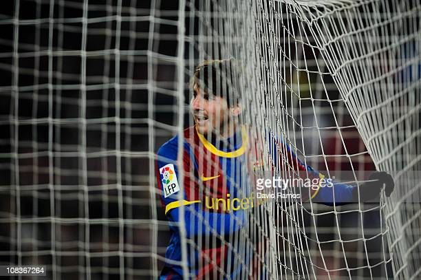 Lionel Messi of Barcelona looks on from the goal during the Copa del Rey Semi Final First Leg match between Barcelona and Almeria at Camp Nou on...