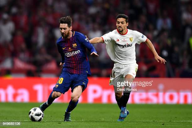Lionel Messi of Barcelona looks to get away from Jesus Navas of Sevilla during the Spanish Copa del Rey match between Barcelona and Sevilla at Wanda...