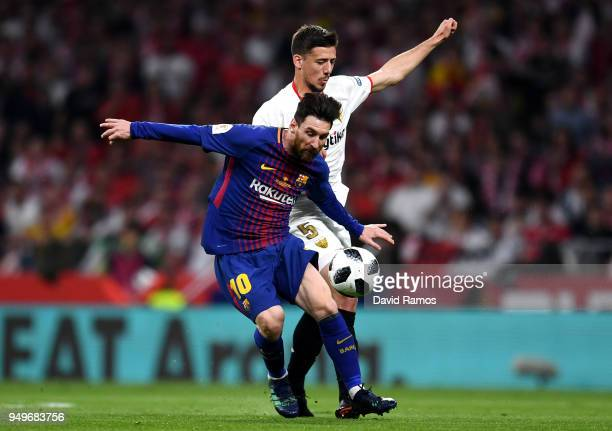 Lionel Messi of Barcelona looks to hold off Clement Lenglet of Sevilla's during the Spanish Copa del Rey match between Barcelona and Sevilla at Wanda...