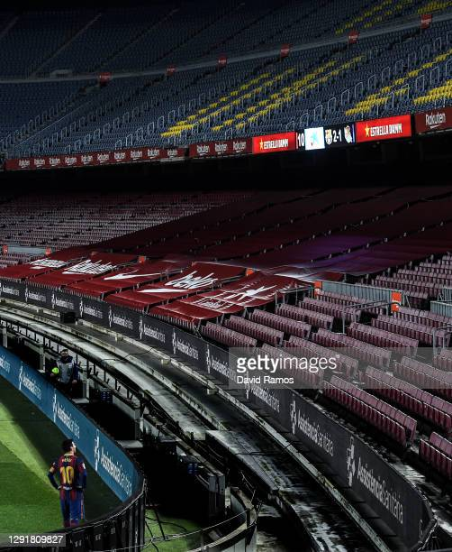 Lionel Messi of Barcelona looks to the empty stands during the La Liga Santander match between FC Barcelona and Real Sociedad at Camp Nou on December...