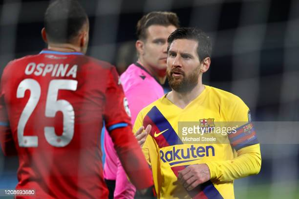 Lionel Messi of Barcelona looks towards David Ospina of Napoli during the UEFA Champions League round of 16 first leg match between SSC Napoli and FC...