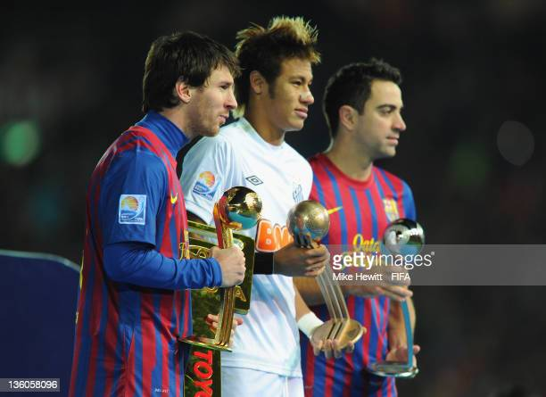 Lionel Messi of Barcelona Neymar of Santos and Xavi of Barcelona hold their respective player of the tournament awards at the FIFA Club World Cup...