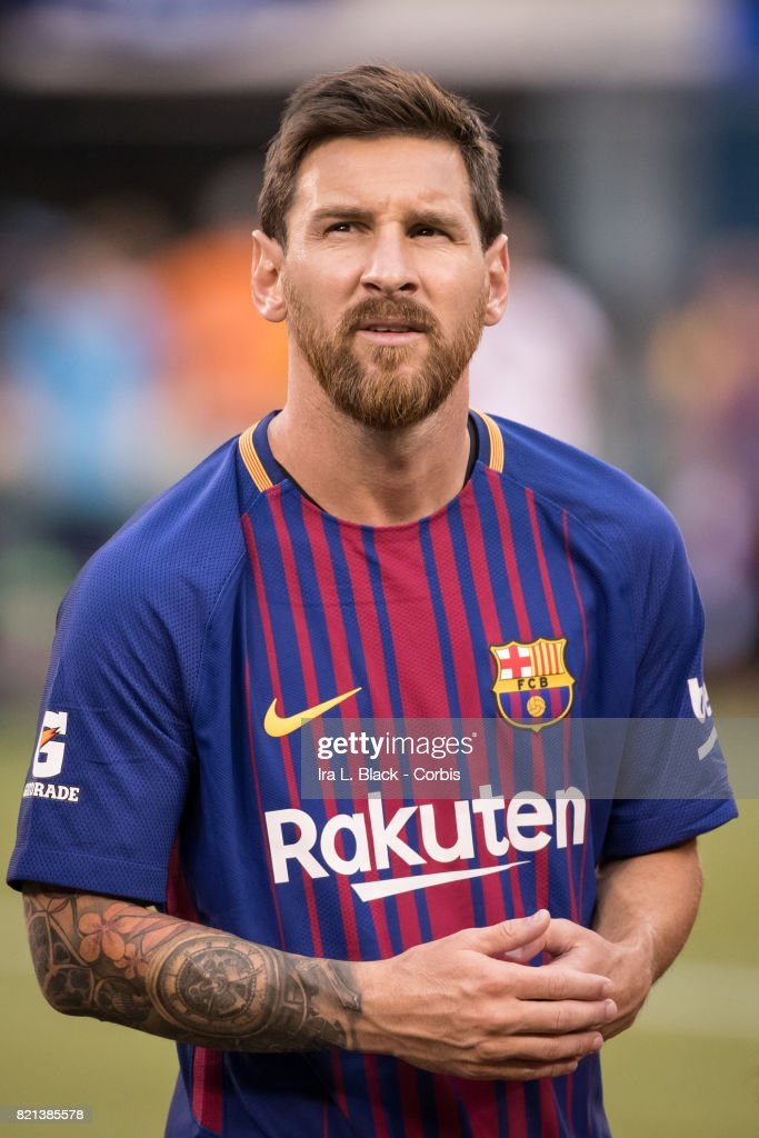 lionel messi of barcelona on the pitch with the new rakuten jersey news photo getty images. Black Bedroom Furniture Sets. Home Design Ideas