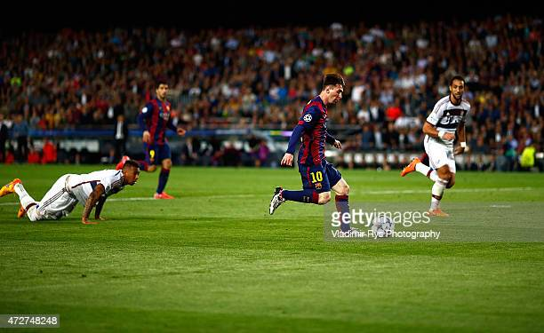 Lionel Messi of Barcelona passes by Jerome Boateng of Bayern to score his second goal during the first leg of UEFA Champions League semifinal match...