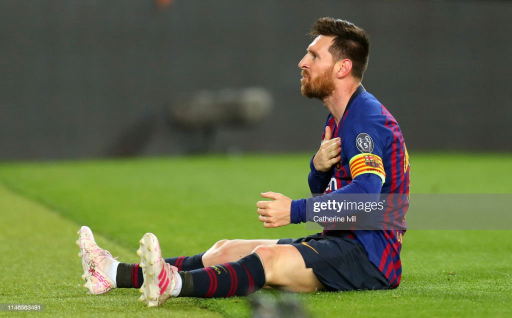 best cheap d9d81 cb727 Lionel Messi of Barcelona pats the badge on his shirt as he ...