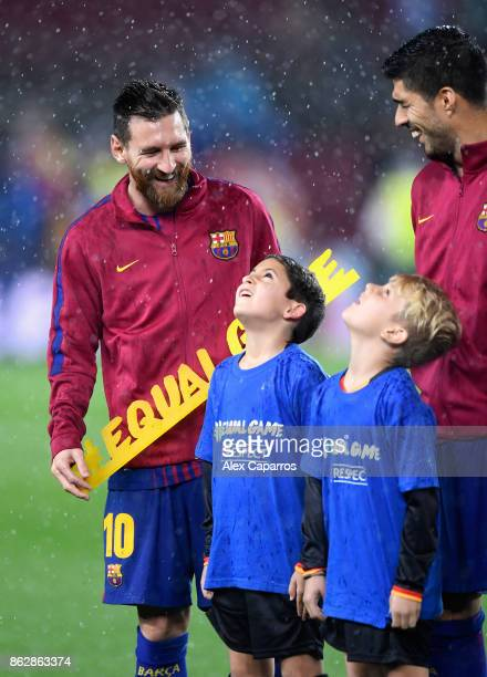 Lionel Messi of Barcelona poses with the #equalgame banner prior to the UEFA Champions League group D match between FC Barcelona and Olympiakos...