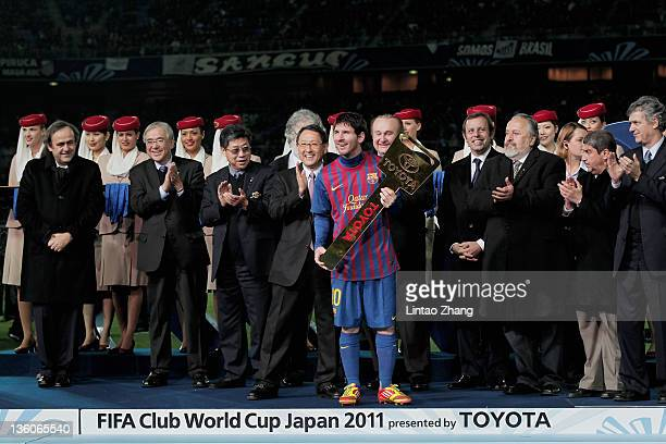 Lionel Messi of Barcelona poses with the Toyota Award the FIFA Club World Cup Final match between Santos and Barcelona at the Yokohama International...