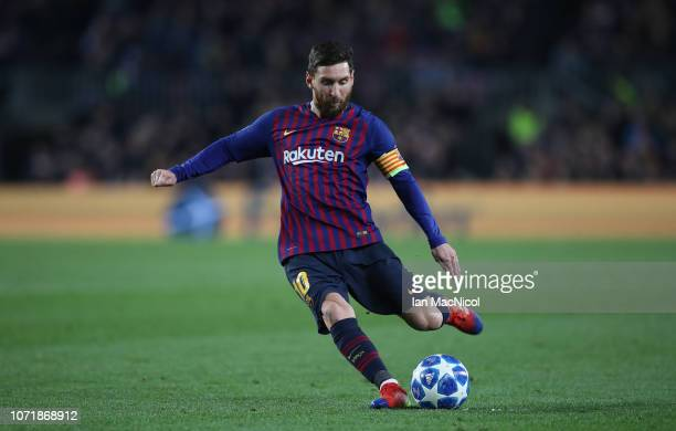 Lionel Messi of Barcelona prepares to take a free kick during the UEFA Champions League Group B match between FC Barcelona and Tottenham Hotspur at...