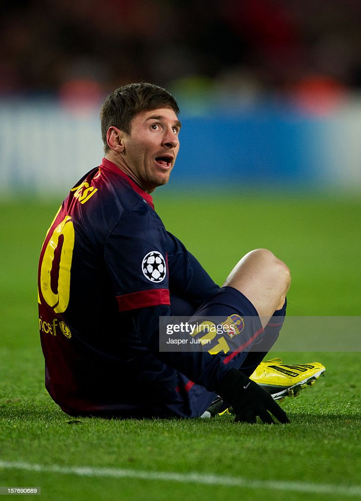 Lionel Messi of Barcelona reacts after being fouled during the UEFA Champions League Group G match between FC Barcelona and SL Benfica at the Camp Nou stadium on December 5, 2012 in Barcelona, Spain. Messi was taken off the pitch.