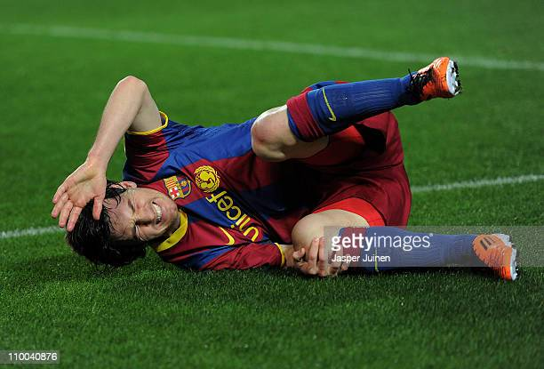 Lionel Messi of Barcelona reacts after colliding with goalkeeper Javier Varas of Sevilla during the la Liga match between Sevilla and Barcelona at...